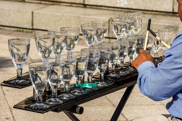Glass Human Hand Drinking Glass Holding Hand Household Equipment One Person Food And Drink Human Body Part Table Large Group Of Objects Indoors  Wineglass Glass - Material Drink Refreshment Alcohol Tray Real People Glasses Music Water Musical Instrument Musician