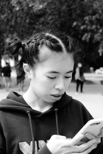 Close-up of young woman using smart phone