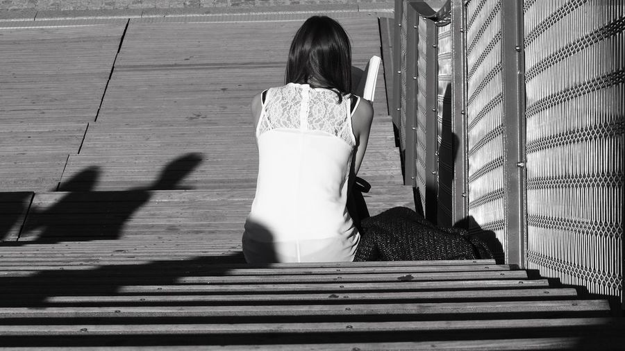 Streetphotography City Cityscape City Life EyeEm Best Shots EyeEmNewHere Blackandwhite Full Length Leisure Activity Lifestyles One Person Outdoors Real People Rear View Shadow Staircase Sunlight Focus On Shadow Steps