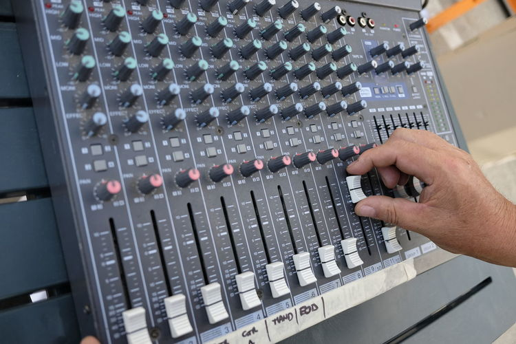 Adjusting Arts Culture And Entertainment Complexity Control Panel Electronics Industry Expertise Human Hand Men Mixing Music Musical Instrument Musician Occupation One Person Push Button Real People Recording Studio Skill  Sound Mixer Sound Recording Equipment Studio Switch Technician Technology
