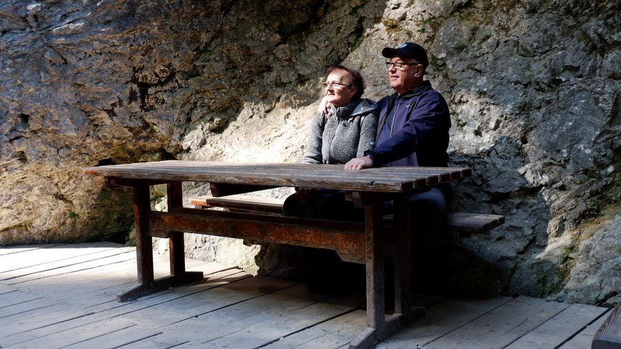 Men sitting on bench