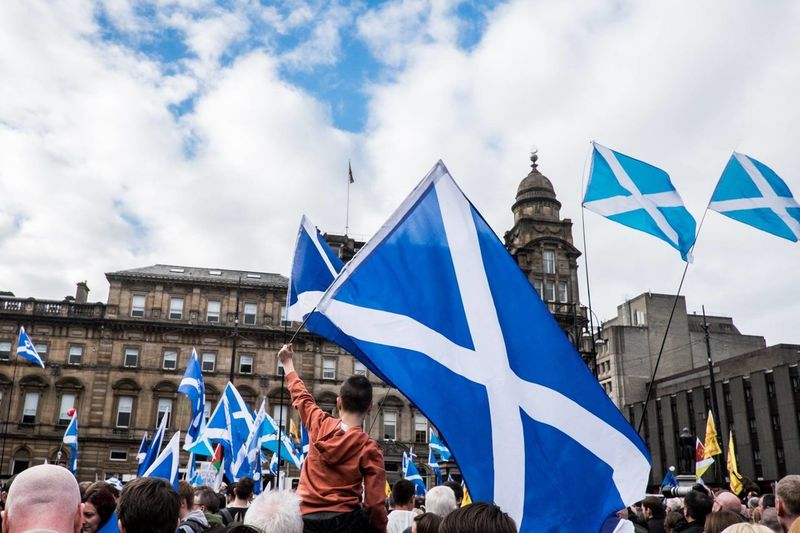 People holding scottish flags