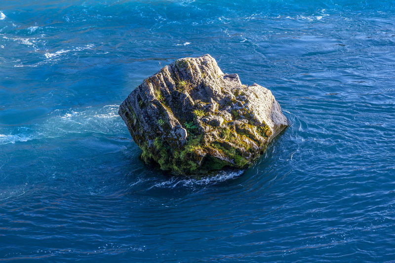 Rock in a river Iceland Nature Nature Photography Resist! Resistance  Travel Travel Photography Adventure Beauty In Nature Blue Blue Sky Day Nature No People Outdoors Rock - Object Sea Steadfast Sunlight Water