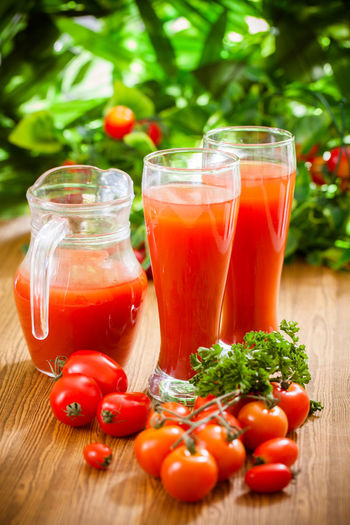 Tomatoes in glass on table