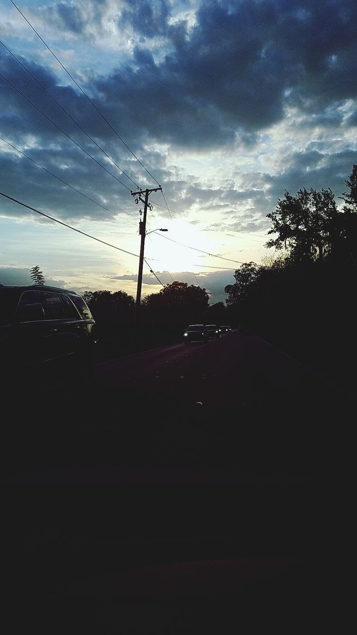 silhouette, sky, car, cloud - sky, tree, transportation, cable, sunset, land vehicle, no people, road, electricity, electricity pylon, telephone line, outdoors, nature, day