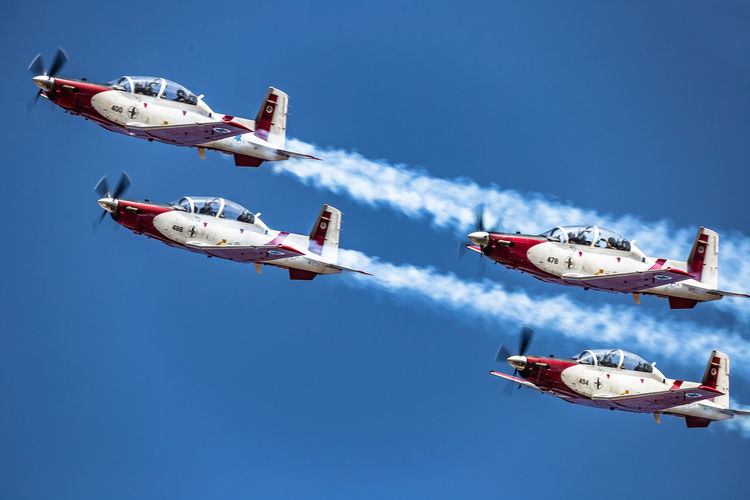 Aerobatic, Team, Flying, Aircraft, Vintage AerobaticTeam Air Vehicle Airplane Airshow Airshow Aviation Beechcraft Blue Blue Sky Day Flying Formation Flying IAF Ii Independence Day Israel Israeli Air Force Low Angle View Mid-air Mode Of Transport Sky Smoke T-6 Texan Transportation