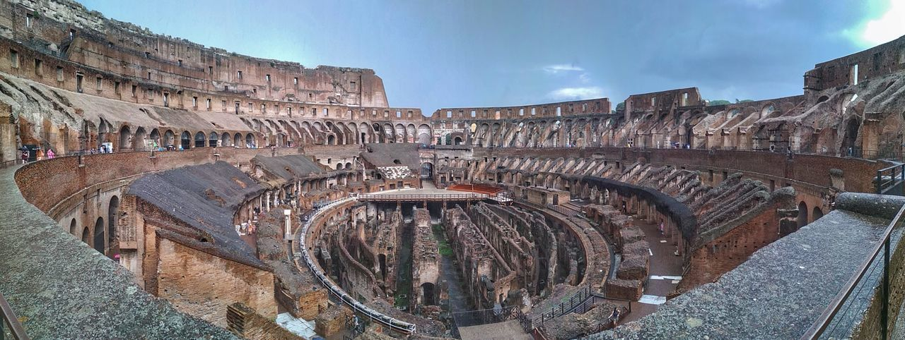 Panoramic view of old amphitheater against sky