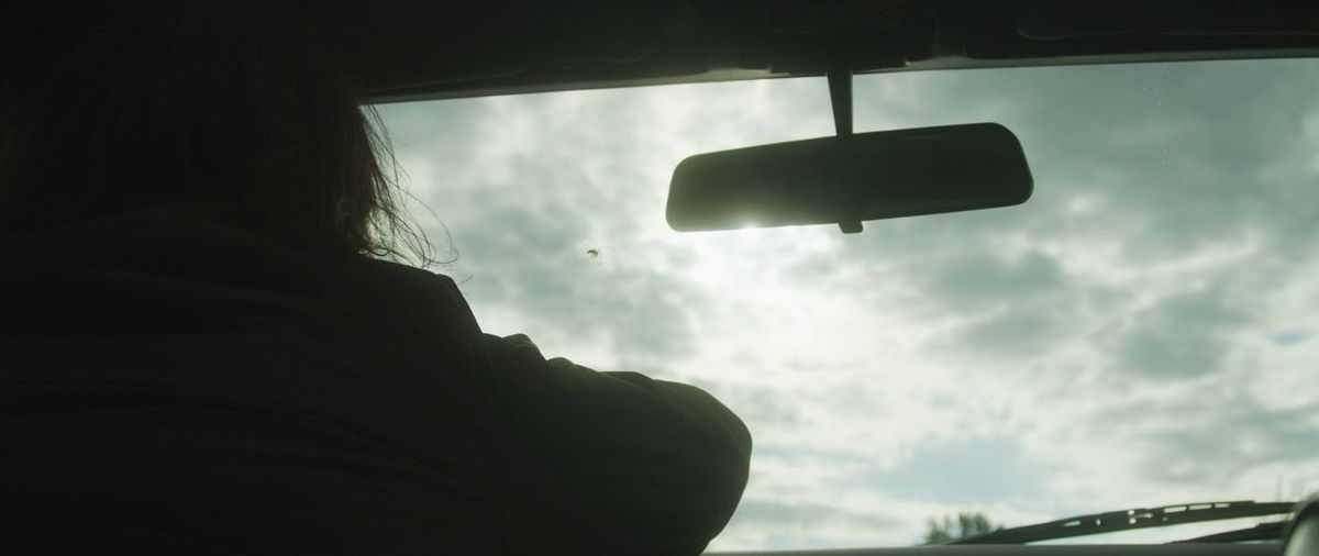 Low angle view of sky seen through car window