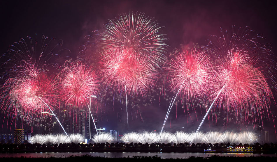 Fireworks Fireworks New Year Arts Culture And Entertainment Celebration Cityscape Event Exploding Festival Firework Firework - Man Made Object Firework Display Illuminated Long Exposure Low Angle View Motion Multi Colored Night No People Outdoors Sky