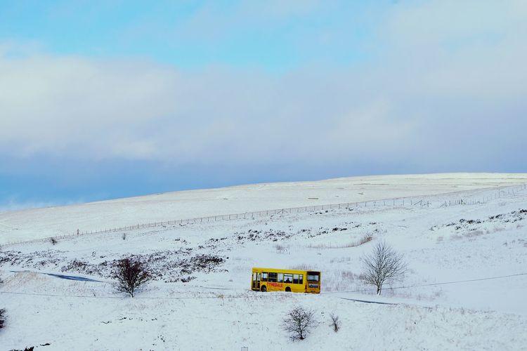 Yellow bus. Winter Tynedale Snow