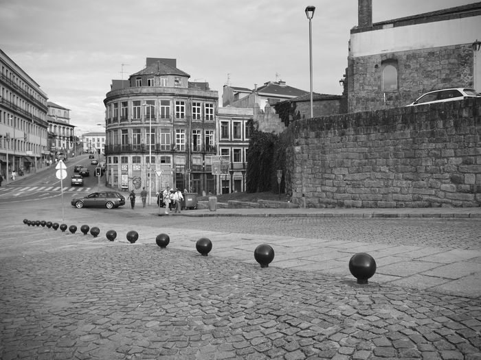 BeW City Cityscape Oporto, Portugal Architecture Ball Black And White Building Building Exterior Built Structure City City Life Day Footpath Monochrome Nature No People Outdoors Residential District Sky Sphere Sport Sports Equipment Street Town Travel Destinations