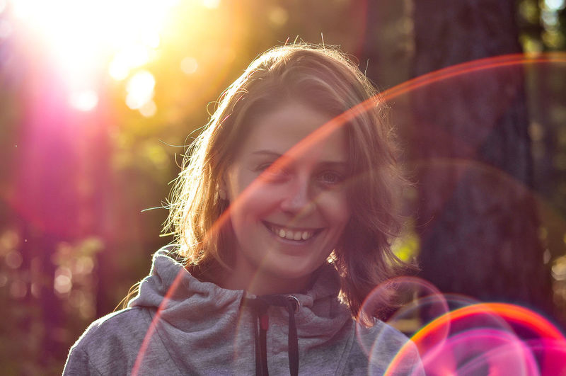 Beautiful Woman Emotion Focus On Foreground Front View Hairstyle Happiness Headshot Leisure Activity Lens Flare Lifestyles Looking At Camera One Person Outdoors Portrait Real People Smiling Sunlight Teeth Toothy Smile Women Young Adult Young Women The Traveler - 2019 EyeEm Awards