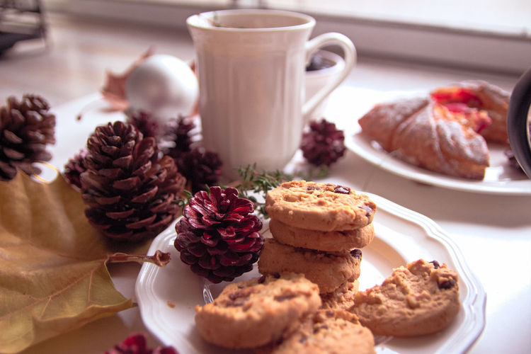 High angle view of cookies and christmas decorations on table