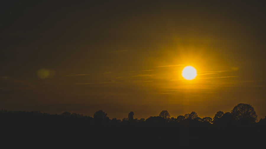Sky Sunset Beauty In Nature Scenics - Nature Tranquility Sun Tranquil Scene Orange Color Silhouette Idyllic Nature Cloud - Sky No People Sunlight Yellow Outdoors Non-urban Scene Lens Flare Tree Majestic Eclipse Romantic Sky EyeEm Best Shots EyeEm Selects EyeEm Gallery My Best Photo