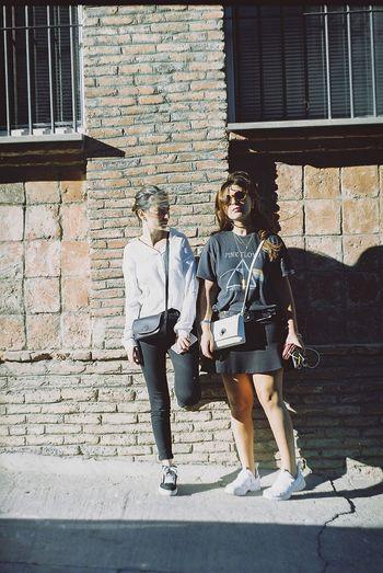 EyeEmNewHere EyeEm eyeemphoto EyeEm Best Shots EyeEm Best Shots Urban Portrait Young Women Full Length City Togetherness Women Sunlight Walking Friend Female Girlfriend Posing Sidewalk
