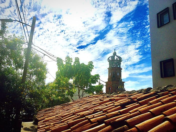 Mexican sky Building Exterior Architecture Built Structure Outdoors No People Low Angle View Sky Day Clock Tower Tree Clock Cathedral Red Roof Tile Red Roofs Redroof Blue Sky Religious Place