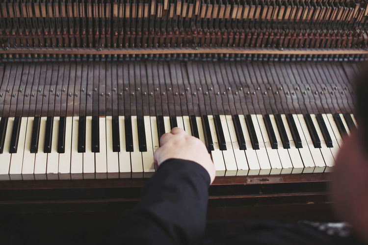 Old style piano Musical Instrument Musical Equipment Music Piano Human Body Part One Person Human Hand Arts Culture And Entertainment Piano Key Real People Hand Body Part Leisure Activity Indoors  Lifestyles Unrecognizable Person Finger Human Finger Keyboard Instrument Playing Keyboard Grand Piano