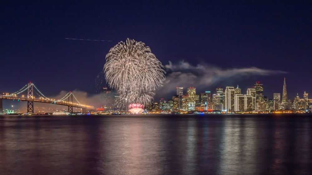 New Years Eve Fireworks 2015 - San Francisco Fireworks New Years Eve 2015 San Francisco Architecture Bridge - Man Made Structure Building Exterior Built Structure City Cityscape Connection Illuminated Long Exposure Night No People Oakland Bay Bridge Outdoors Sky Skyscraper Travel Destinations Urban Skyline Water Waterfront