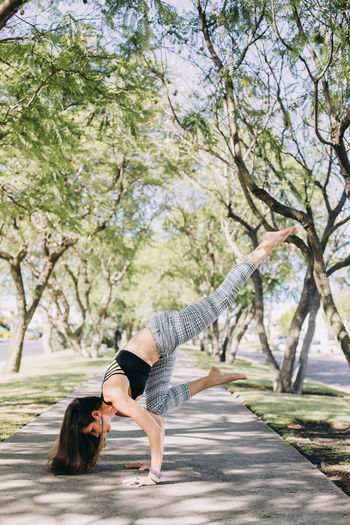 Woman of mexican ethnicity 35-39 years old doing a yoga pose of handstand with splits