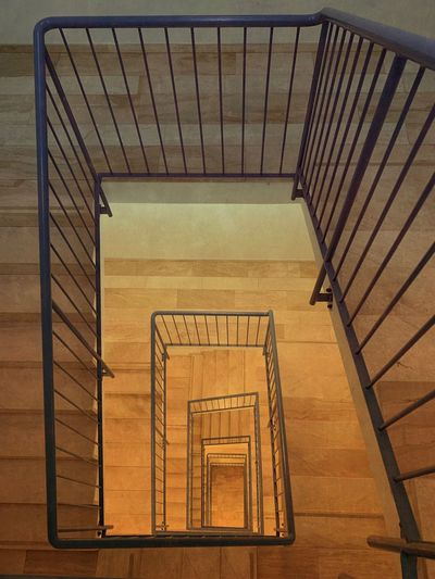 Staircase Railing Architecture Built Structure Steps And Staircases Pattern No People Spiral Spiral Staircase High Angle View Design Indoors  Directly Above Brown Metal Shape Day Wood - Material Repetition