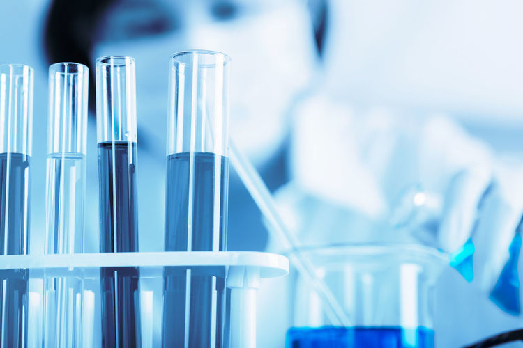 Female scientist holding medical sample at laboratory