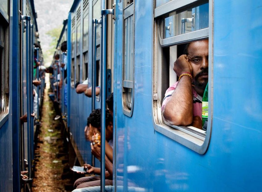The Journey Is The Destination Two trains stop next to each other in Sri Lanka Sri Lanka Sri Lankan Train Trains Train Tracks Trainphotography Blue Interesting Faces Interestingpeople People Watching People Photography