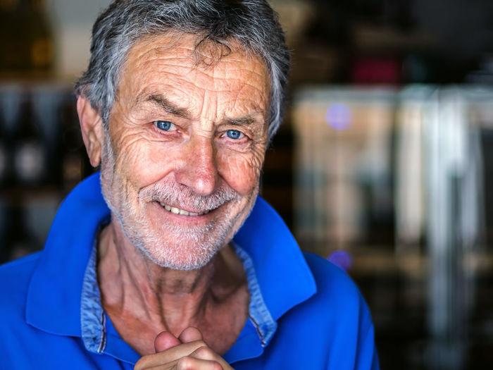 Portrait of smiling senior man with blue eyes