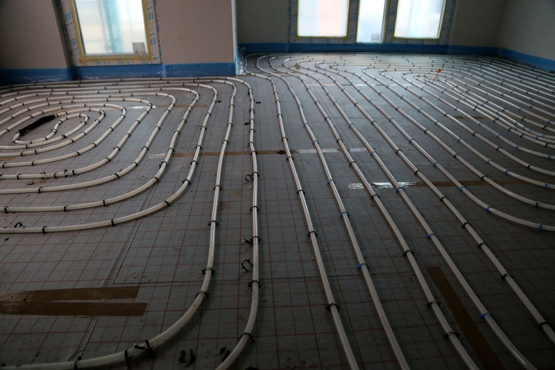 underfloor heating being installed - warm water tubes layout. Fußbodenheizung wird verlegt im Neubau. Absence Architectural Feature Architecture Backgrounds Building Built Structure Close-up Day Design Diminishing Perspective Empty Full Frame Geometric Shape Modern No People Repetition The Way Forward Floor Heating Fussbodenheizung Heated Floor Underfloor Heating Neubau Neubauten Construction Screed Heating