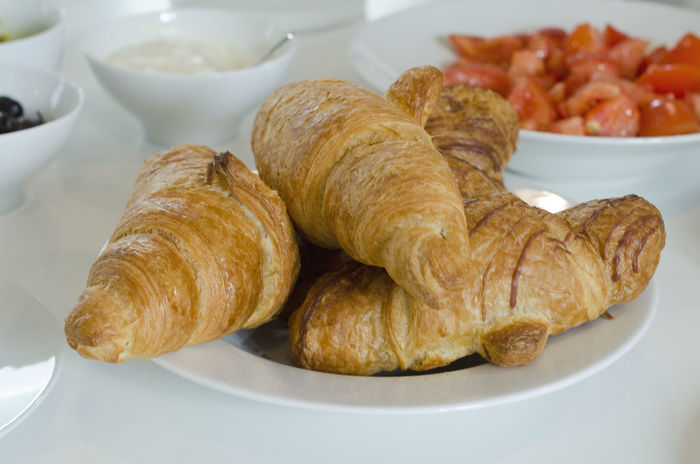 Croissants served for breakfast, ready to enjoy. Bread Break Brunch Close-up Croissant Day Food Food And Drink French Food Freshness Group Of Objects Healthy Eating Indoors  No People Plate Ready-to-eat Served