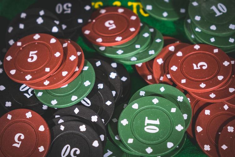 Full frame shot of colorful gambling chips in casino