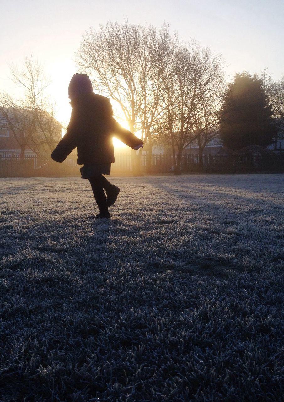 Girl Running In Park At Sunset