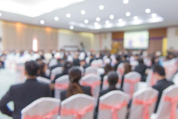 Defocused image of business conference in auditorium