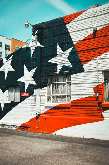 US flag street painting Graffiti Patriotism US Flag USA United States Architecture Art Building Exterior Built Structure Day Flag Flags No People Outdoors Red White And Blue Sky Street Art Street Painting The USA Transportation Urban Art Vereinigte Staaten