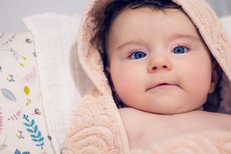 baby after taking a bath Freshness Hygiene Clean Bath Time Bathroom Towel Childhood Child Portrait Innocence Baby Young Cute Indoors  Babyhood Looking At Camera Relaxation Headshot Front View Toddler  Human Face