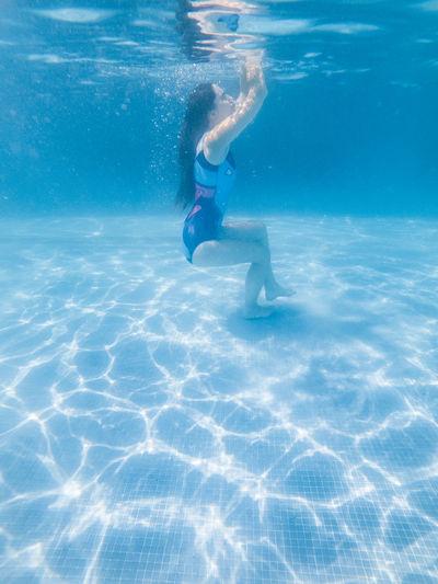 Full length of woman in swimming pool