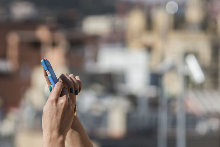 Cropped image of woman using mobile phone