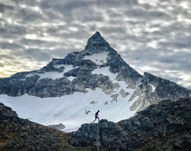Trailrunning Skyrunning Sky Cloud - Sky Nature Real People Mountain Snow One Person Leisure Activity Beauty In Nature Outdoors Scenics - Nature Cold Temperature Mountain Peak Snowcapped Mountain Men Holiday Standing Winter Day Tranquility First Eyeem Photo