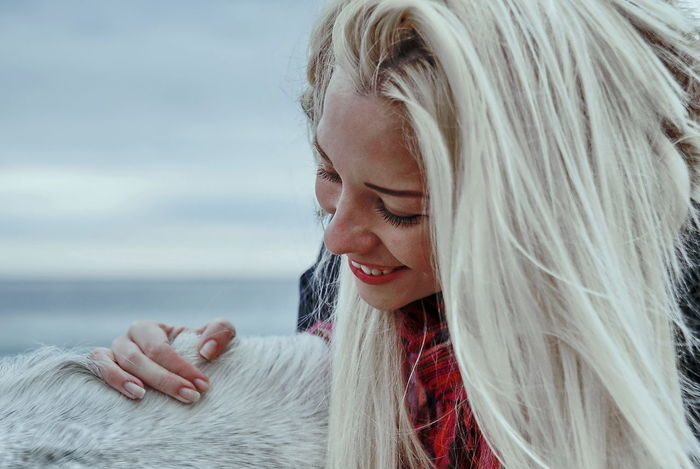 Girl and horse Adult Adults Only Beautiful People Beautiful Woman Beauty Blond Hair Close-up Cold Temperature Day Human Body Part Nature One Person One Woman Only Only Women Outdoors People Portrait Sky Smiling Sweater Uniqueness Warm Clothing Winter Women Uniqueness EyeEmNewHere Women Around The World
