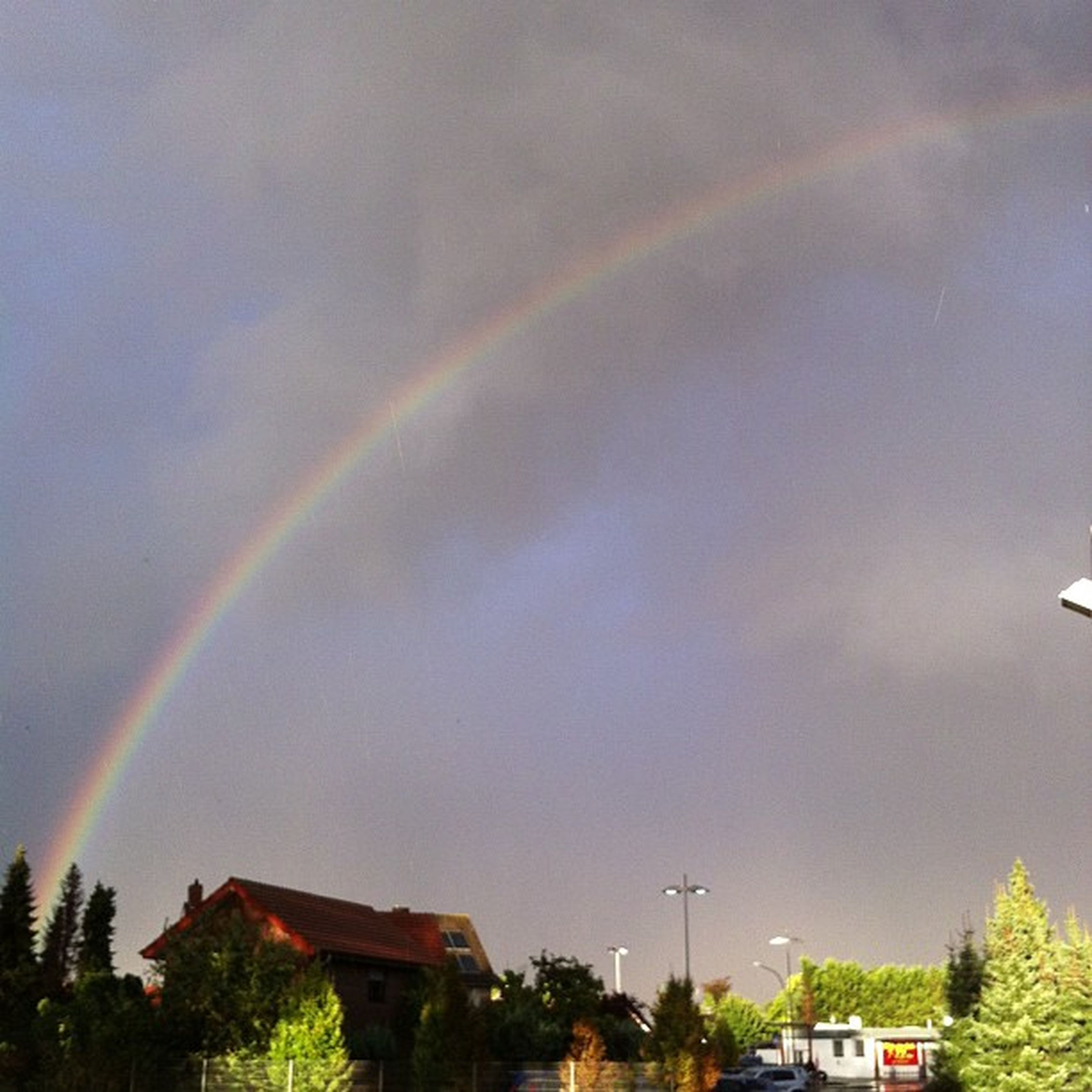 rainbow, building exterior, built structure, architecture, sky, house, tree, cloud - sky, multi colored, residential structure, weather, cloudy, nature, low angle view, residential building, outdoors, beauty in nature, no people, overcast, dusk