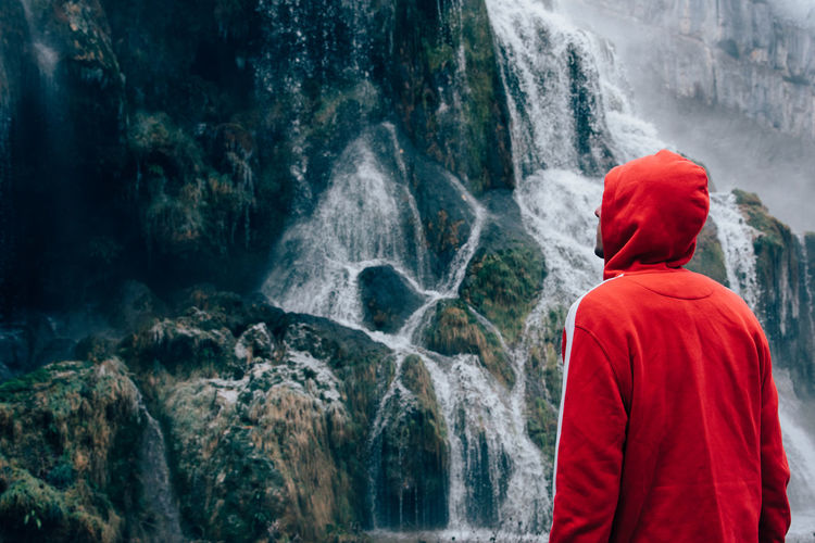 Waterfall Winter Froozen Cold Temperature Rear View Waterfall Red One Person Women Real People Standing Water Day Lifestyles Outdoors Men Nature People Adult Adults Only Beauty In Nature Young Adult Rock - Object Rock Formation Long Exposure Motion Power In Nature Cliff Scenics