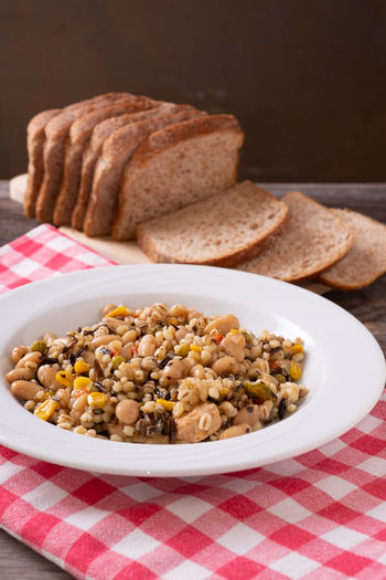 Spelled, chickpea, tuna and corn salad arranged on rustic table with bread Bean Bowl Bread Checked Pattern Close-up Focus On Foreground Food Food And Drink Freshness Healthy Eating Indoors  Legume Family No People Plate Ready-to-eat Still Life Studio Shot Table Tablecloth Vegetable Vegetarian Food Wellbeing