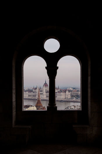 LOVE, BUDAPEST Built Structure Building Exterior Budapest Window Window View Looking Out Of The Window Hungary City Cityscape Dome Triumphal Arch History Arch Clock Face Architectural Column Architecture
