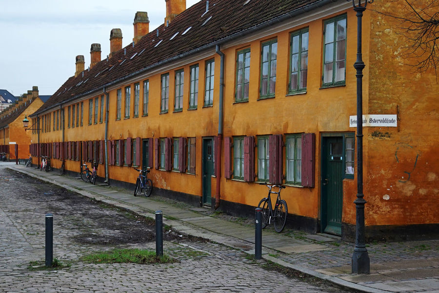 A line of orange houses Architecture Building Building Exterior City Day Famous Place First Eyeem Photo No People Orange Orange Colour Residential Building Street Symmetry The Danish Girl Travel Travel Photography Traveling Windows Colour Of Life Color Palette Neighborhood Map