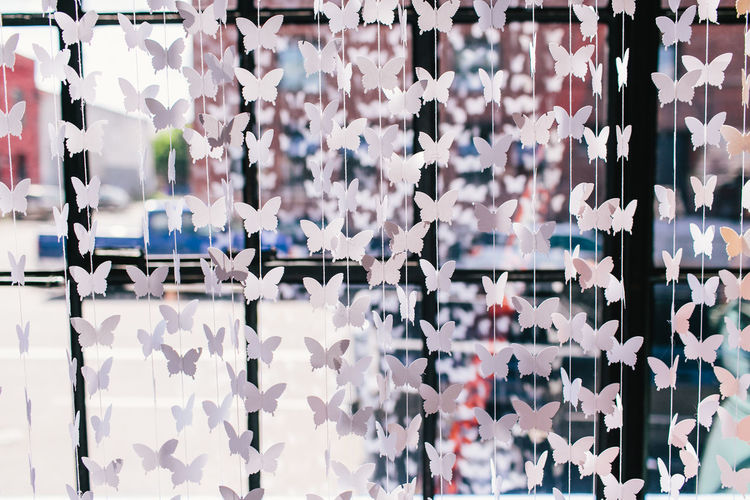 Full Frame Shot Of Paper Decoration Hanging On Window