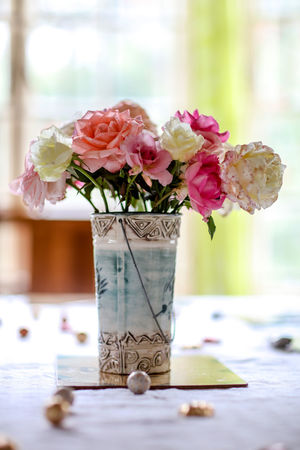 Table arrangement | high res image available Celebration Chocolates Flower Arangement Flower Vase Flowers Home Grown Red Roses Roses South Africa Table Decoration Table Flowers Vase