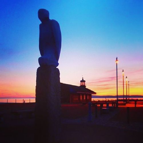 Keeping watch Statue Pier Lighthouse Morecambe morecambebay morecambebeach beach summertime summer sunset rich beautiful peaceful tranquil holiday