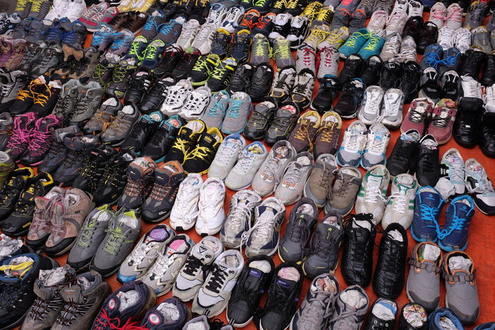 Pre-loved shoes on sale at car boot sale market. Arrangement Business Car Boot Sale Cheap Choice Close-up Collection For Sale In A Row Large Group Of Objects Market Market Stall Multi Colored No People Outdoors Pre-loved Objects Price Tag Retail  Shoe Variation