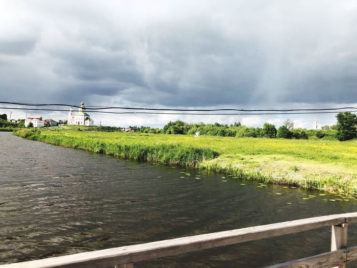 Cloud - Sky Sky Nature Day Plant No People Land Road Tranquil Scene Green Color Growth Tranquility Scenics - Nature Beauty In Nature Water Animal Boundary Animal Themes Barrier Outdoors