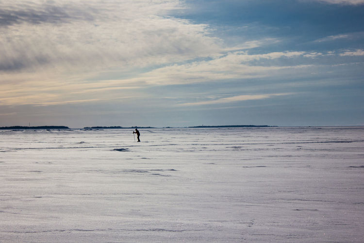 Skiing over the sea at -20ºC Ice Winter Beach Beauty In Nature Cloud - Sky Horizon Horizon Over Water Land Nature Non-urban Scene One Person Outdoors Real People Scenics - Nature Sea Sky Snow Sport Tranquil Scene Tranquility Unrecognizable Person Water The Great Outdoors - 2018 EyeEm Awards