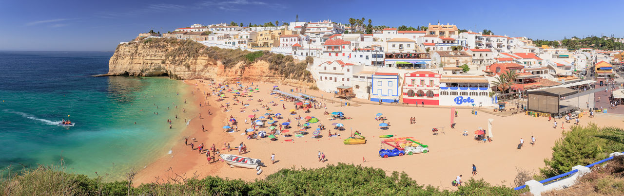 Beach life in Carvoeiro at the Algarve Coast Water Sea Beach Nature Land Travel Destinations High Angle View Outdoors Travel Group Of People Built Structure Sky Architecture Day City Carvoeiro Carvoeiro Beach Algarve Portugal Panorama Panoramic Beach Life Beach Time